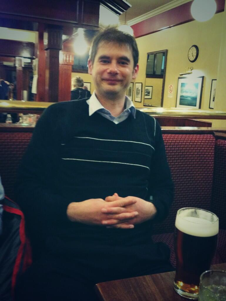 Chris relaxing after a strong viva performance.